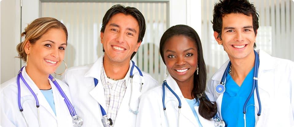 four doctors smiling